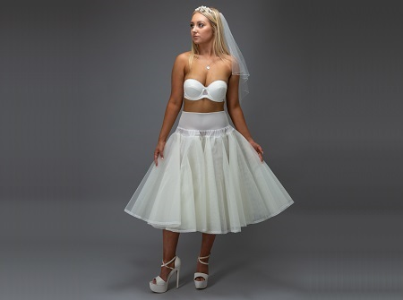bride in a white short petticoat with veil and heels