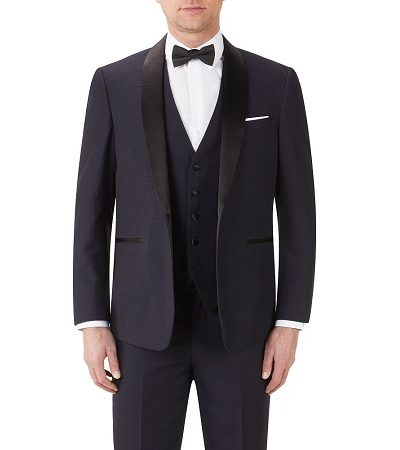 Full navy suit with a navy dicky bow modelled on a man 2